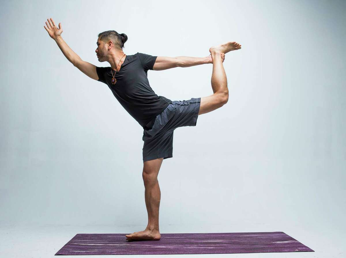Today's #ReNewYogaChallenge pose of the dayis Dancer demonstrated by local yoga instructor John Tran, Tuesday, May 14, 2019.