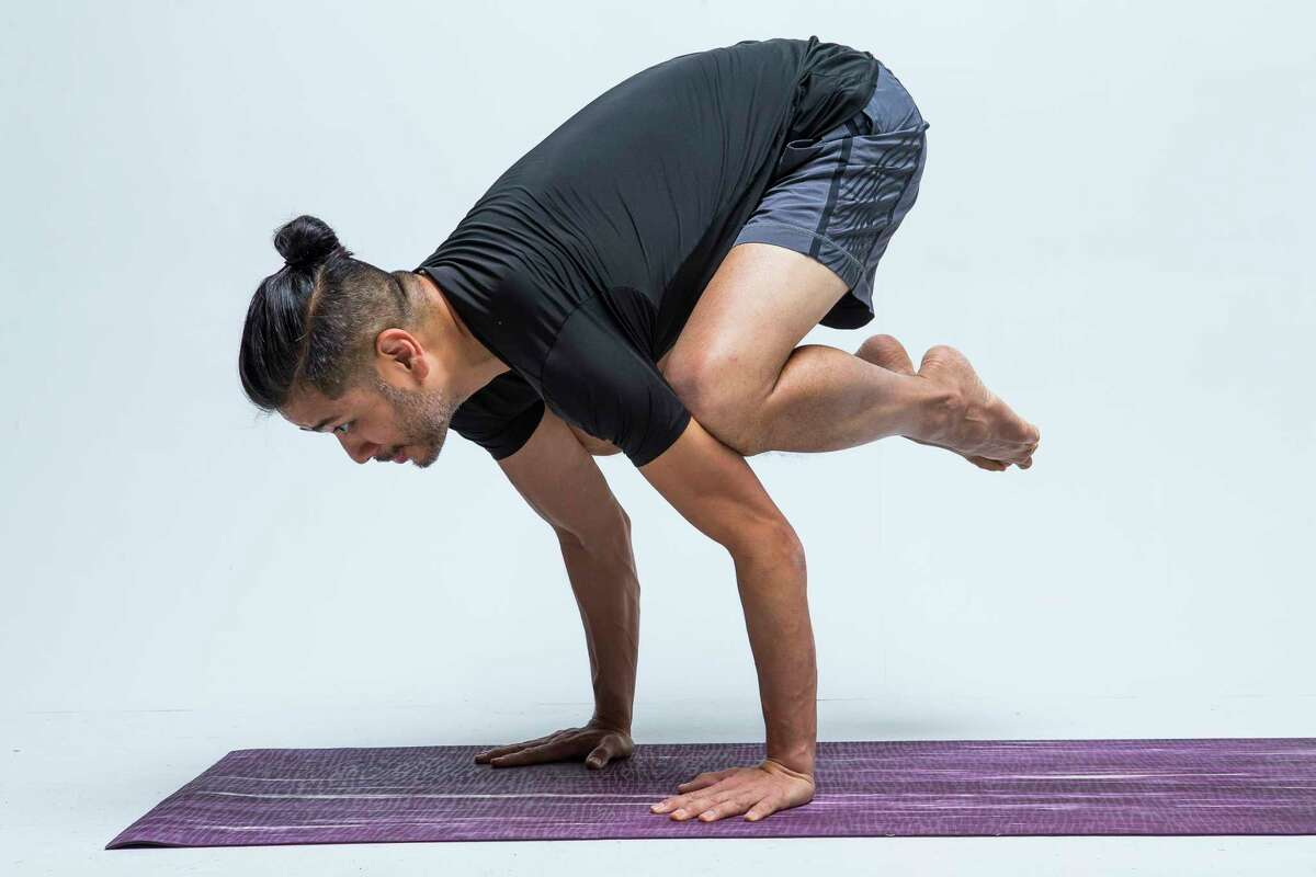 Today's #ReNewYogaChallenge pose of the day is Crow demonstrated by local yoga instructor John Tran, Tuesday, May 14, 2019.