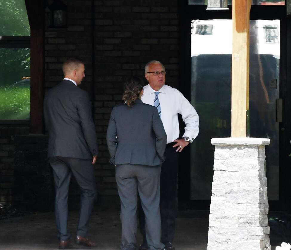 Ronald Riggi speaks with federal agents during a raid of his business, Turbine Services Inc., on Tuesday, June 25, 2019, on Old Gick Road in Wilton, N.Y. Agents and members of the U.S. Department of Homeland Security and Commerce Department arrived at the facility at 9 a.m. (Will Waldron/Times Union)