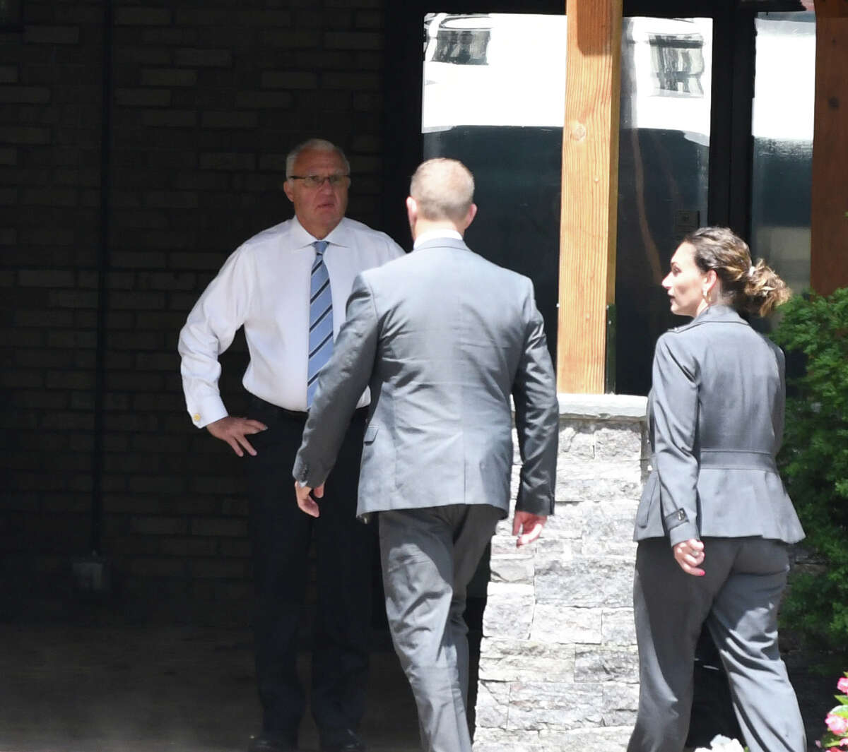 Ronald Riggi speaks with federal agents during a raid of his business, Turbine Services Ltd., on Tuesday, June 25, 2019, on Old Gick Road in Wilton, N.Y. Agents and members of the U.S. Department of Homeland Security and Commerce Department arrived at the facility at 9 a.m. (Will Waldron/Times Union)