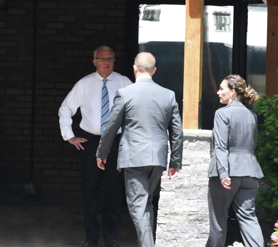 Ronald Riggi speaks with federal agents during a raid of his business, Turbine Services Ltd., on Tuesday, June 25, 2019, on Old Gick Road in Wilton, N.Y. Agents and members of the U.S. Department of Homeland Security and Commerce Department arrived at the facility at 9 a.m. (Will Waldron/Times Union) Photo: Will Waldron, Albany Times Union