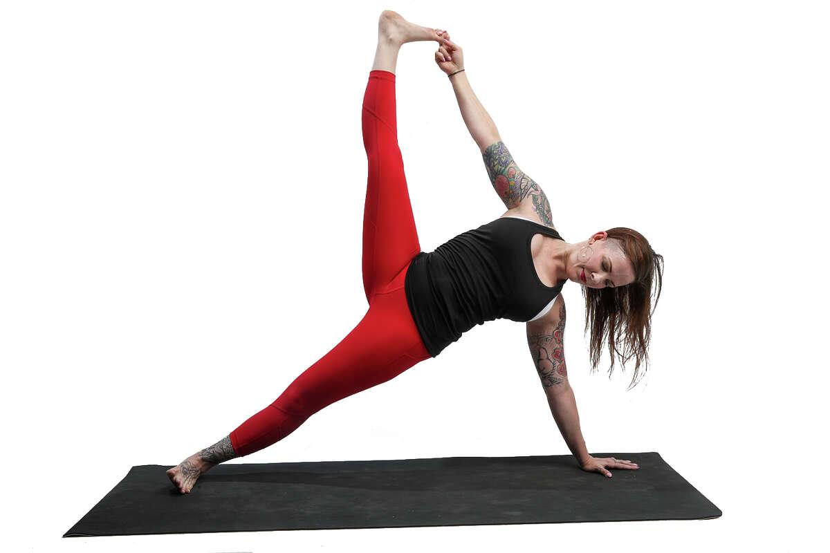 Local yoga instructor Amanda Field demonstrates Side Plank.