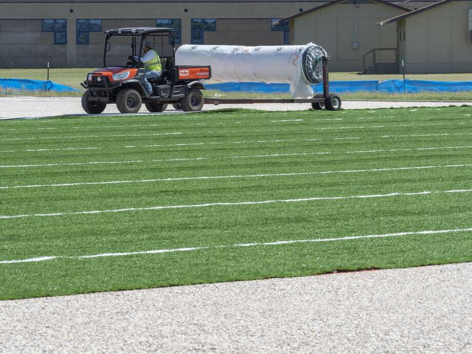 Work continues 06/25/19 at Abell Junior High, as well as other MISD junior high campuses, on installation of new turf practice fields at the schools. Tim Fischer/Reporter-Telegram Photo: Tim Fischer/Midland Reporter-Telegram