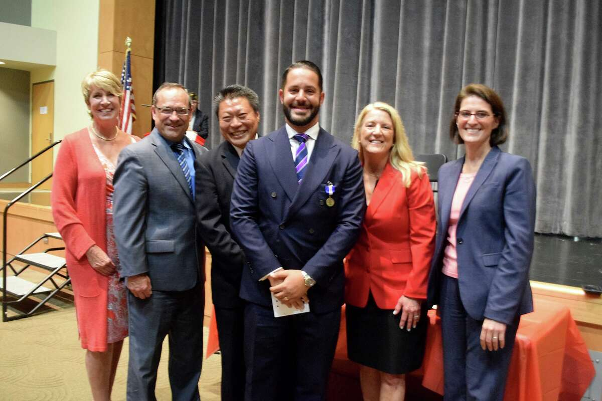 From left, State Rep. Laura Devlin, Department of Veterans' Affairs, (DVA) Director of Projects and Operations Joe Danao, State Sen. Tony Hwang, Fairfield Veteran Alex Plitsas, center, with State Reps. Brenda Kupchick and Cristin McCarthy Vahey awarding one of the almost 200 veterans a Connecticut Wartime Service Medal.