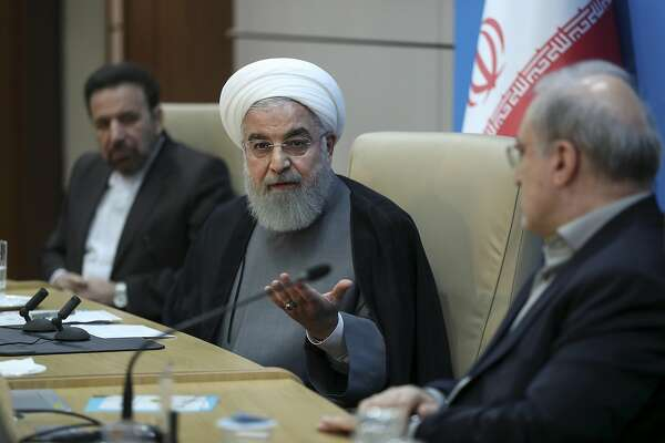 "In this photo released by the official website of the office of the Iranian Presidency, President Hassan Rouhani speaks in a meeting with the Health Ministry officials, in Tehran, Iran, Tuesday, June 25, 2019. Iran on Tuesday sharply criticized new U.S. sanctions targeting the Islamic Republic's supreme leader and other top officials, saying the measures spell the ""permanent closure"" for diplomacy between the two nations. For his part, Iran's president described the White House as ""afflicted by mental retardation."" (Iranian Presidency Office via AP)"