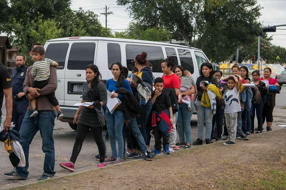 Central American migrants arrive at a Catholic charity after being released from federal detention in McAllen, Texas. Photo: Loren Elliott / AFP / Getty Images