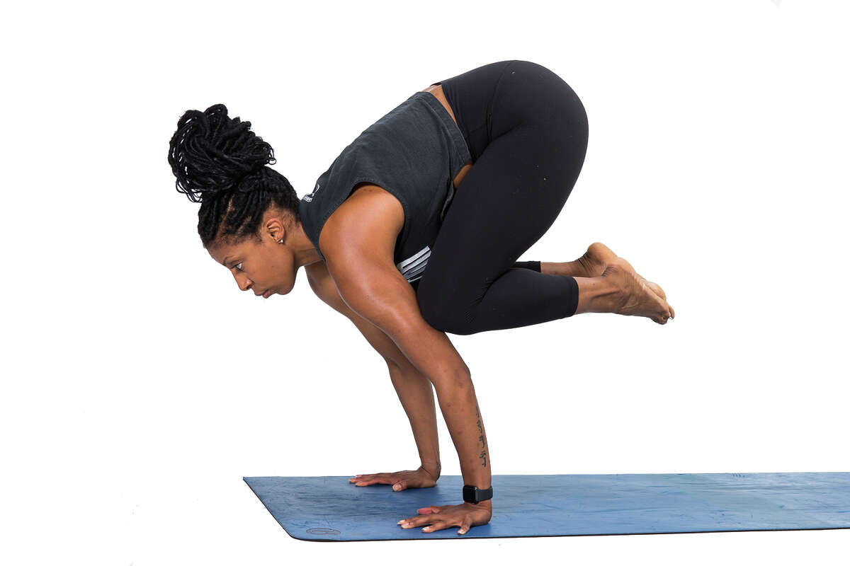 Today's #ReNewYogaChallenge pose of the day is Crow demonstrated by local yoga instructor Alicia Tillman, Tuesday, May 14, 2019.