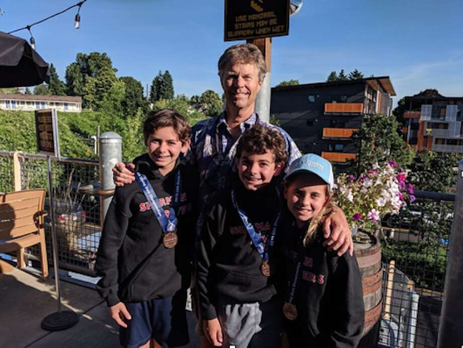 Sofie with Michael Solomon (left), who dove in the Boys 12-13 age group in both the 1 meter and 3 meter springboard events, placing 7th on 3m and 6th on 1m. and brother Jake Solomon who competed in the Boys 11 & Under 1 meter event, placing 7th. Photo: SportStars Magazine