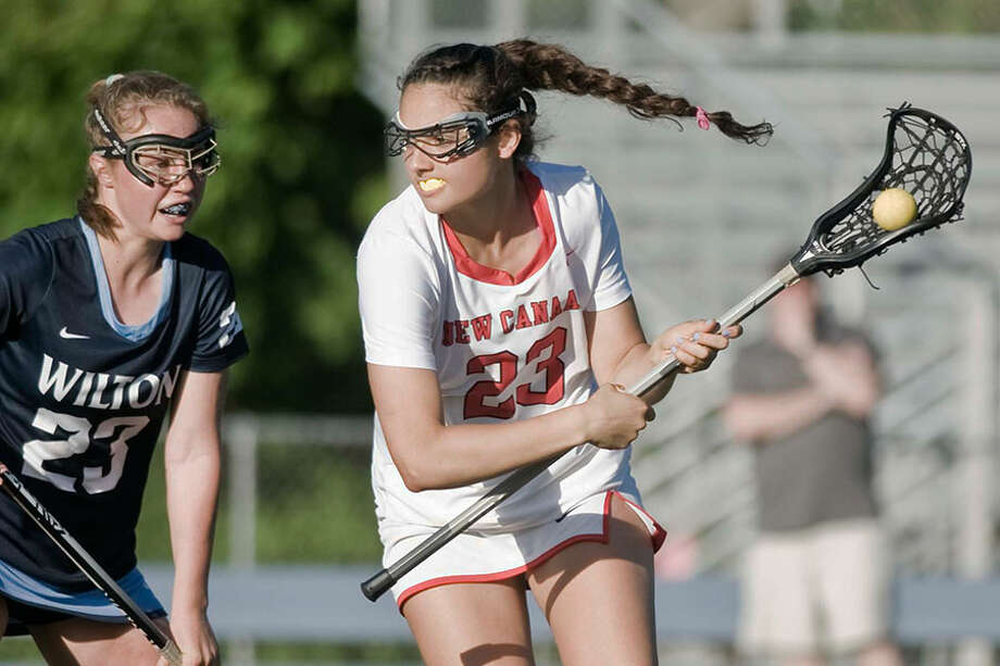 New Canaan's Karlie Bucci scored five goals in the FCIAC semifinals on Monday, but the Rams fell to Wilton 10-8. — Scott Mullin photo / Scott Mullin ownership