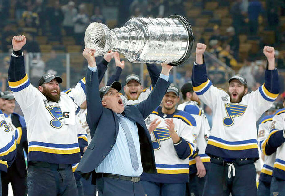 Craig Berube has ahgreed to a three-year deal to remain head coach of the St. Louis Blues. Berube is shown celebrating with the Blues after coaching them to the Stanley Cup championship. Photo: AP Photo
