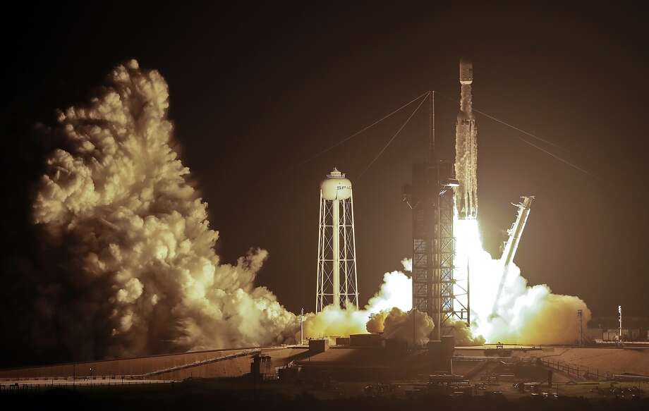 A SpaceX Falcon heavy rocket lifts off from pad 39A at the Kennedy Space Center in Cape Canaveral, Fla., early Tuesday, June 25, 2019. The Falcon rocket has a payload military and scientific research satellites. (AP Photo/John Raoux) Photo: John Raoux, Associated Press