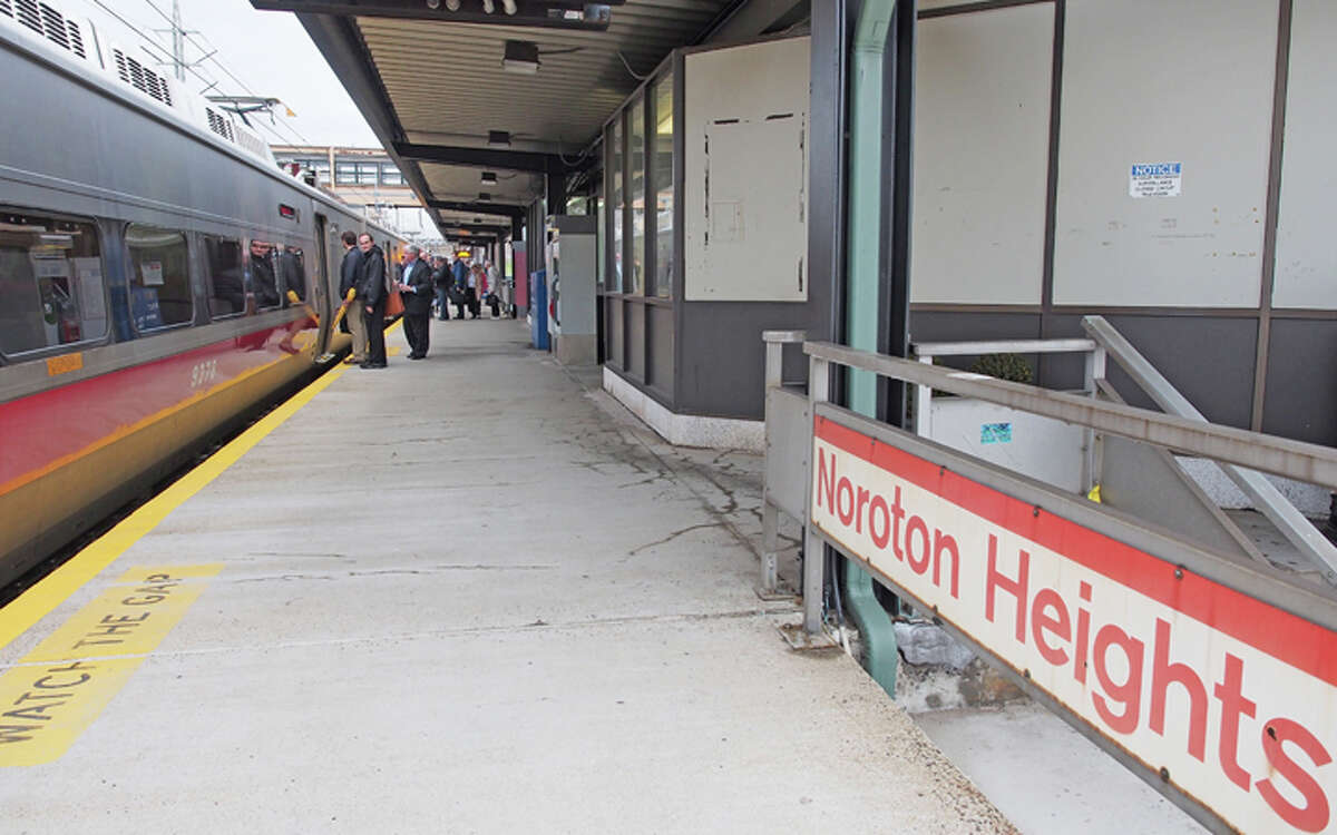 Passengers board a train at the Noroton Heights Metro-North Rail station - Aaron G. Marsh photo