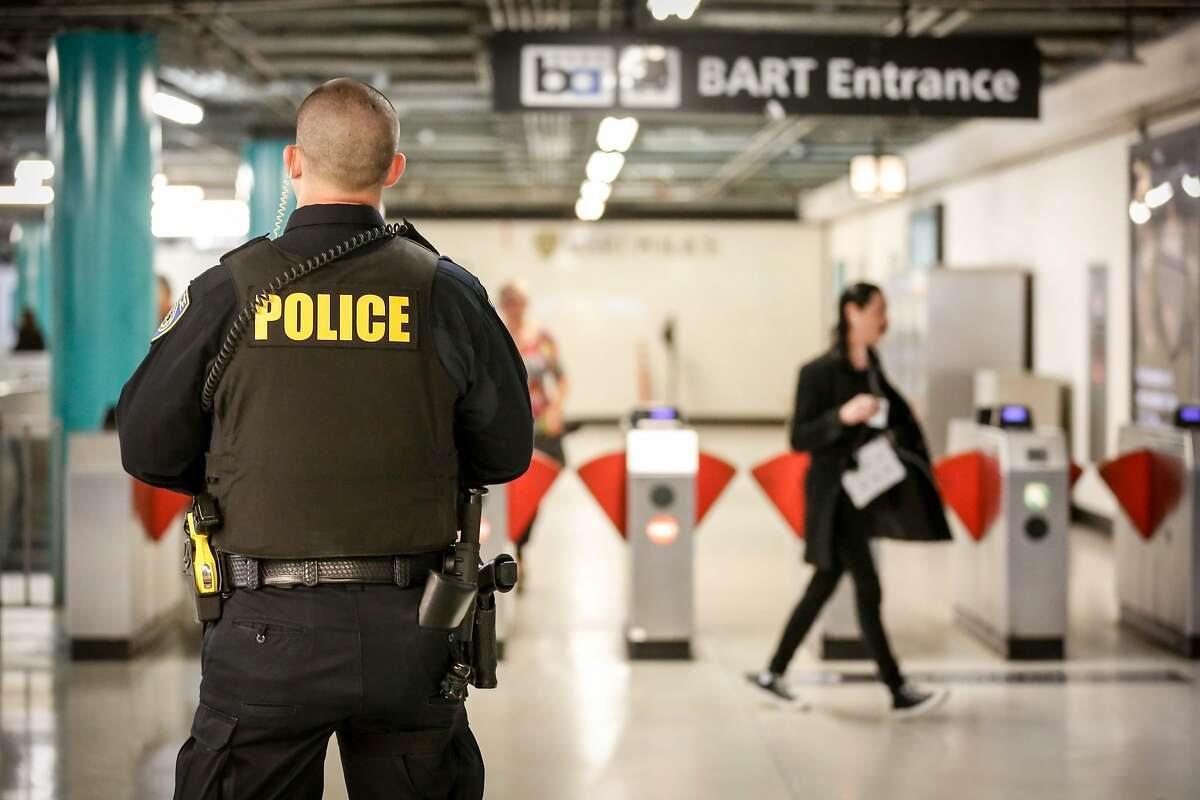Police officer stands guard at Powell Station BART entrance on Monday, April 8, 2019 in San Francisco.