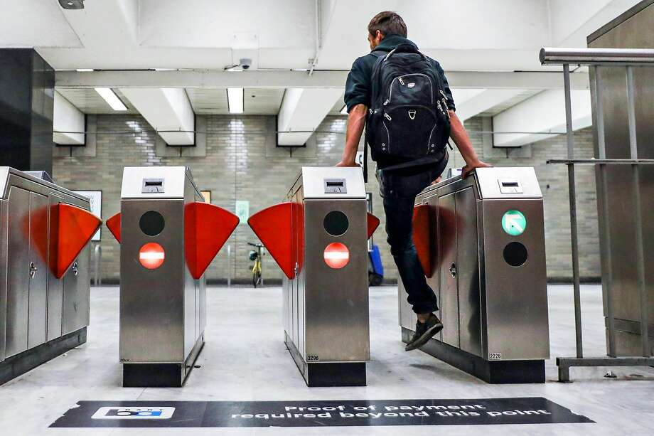 A man jumps the turnstile at the BART station at Civic Center despite gates that were installed (seen at left and right) to deter fare evasion in San Francisco, California, on Thursday, Aug. 16, 2018. Photo: Gabrielle Lurie, The Chronicle