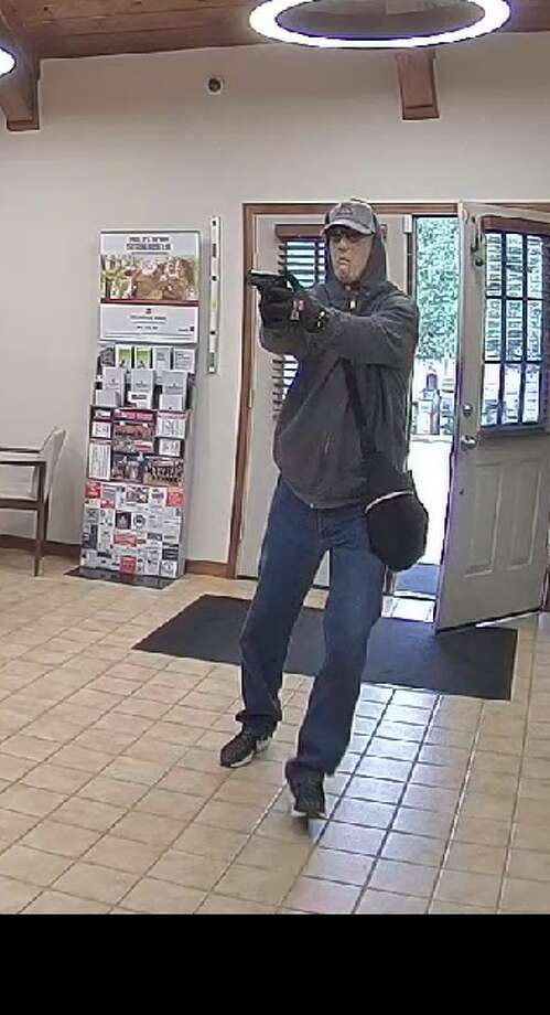 The Texas Bankers Foundation is offering a $5,000 reward for info on this bank robber, who held up a bank in the 14700 block of Ranch Road 12 in Wimberley on June 20, 2019. Photo: Hays County Sheriff's Office