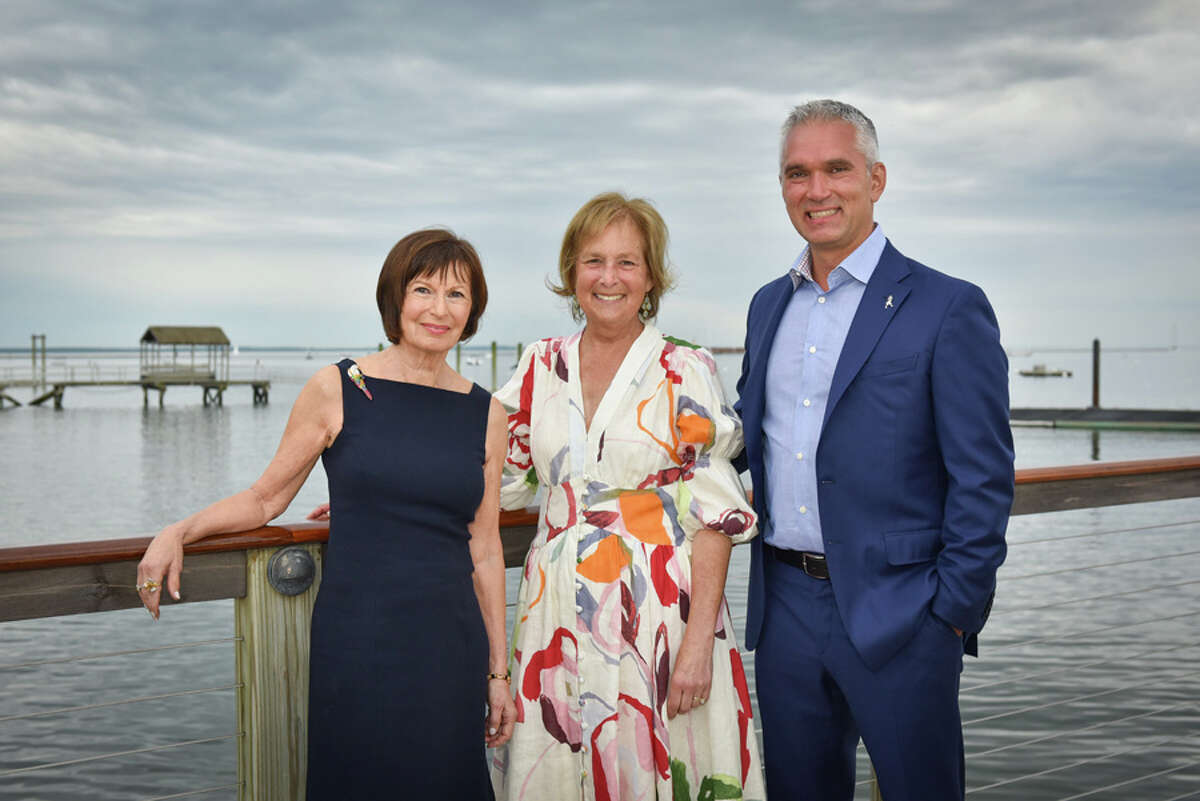 Artist Award winner Fran Meehan, Legacy Award winner Pamela Davis, and Svetlin Tchakarov who accepted the Corporate Award on behalf of Diageo, take in the surroundings at the Stamford Yacht Club, site of Silvermine's Living Art Awards. Silvermine Arts Center / Contributed photo