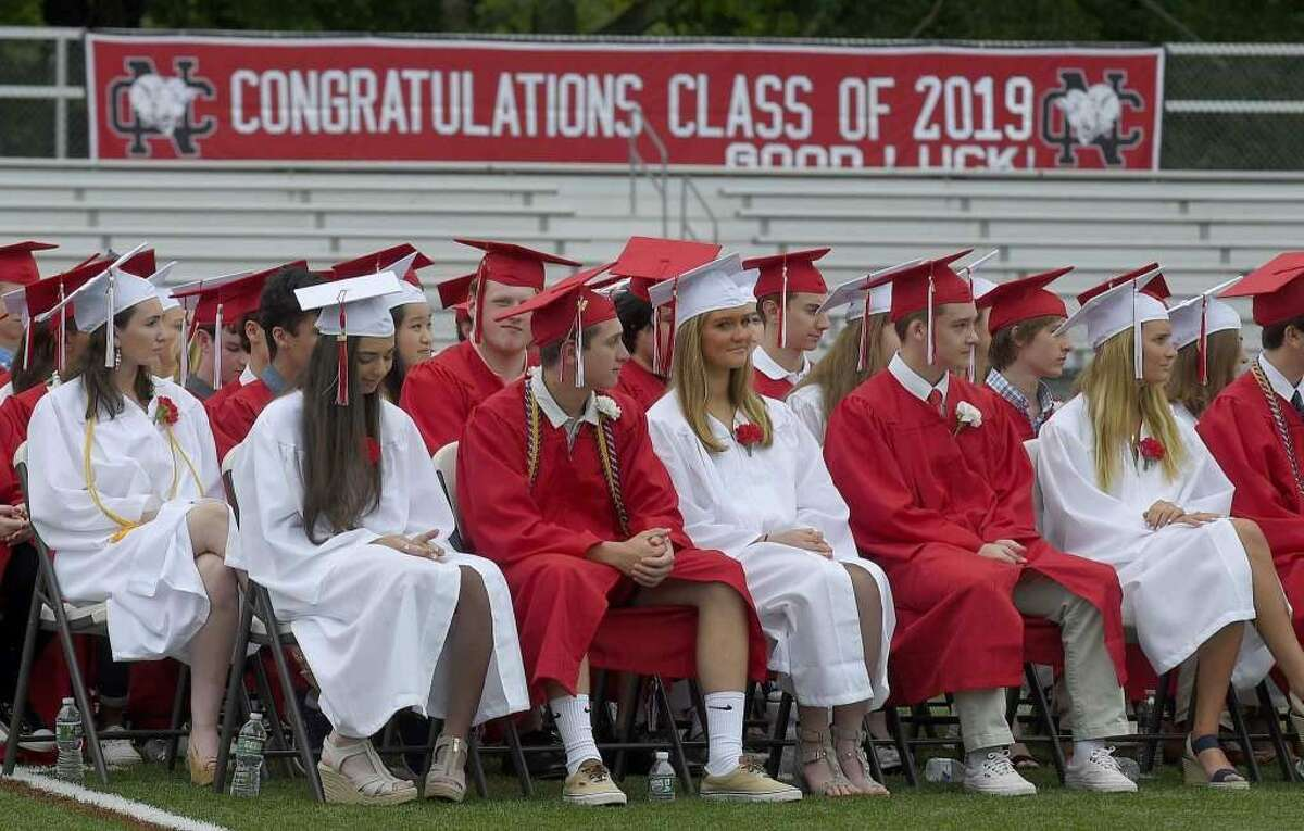 After a day's delay due to weather, the New Canaan High School Class of 2019 graduated on Dunning Field Wednesday, June 19. - Matthew Brown/Hearst Connecticut Media