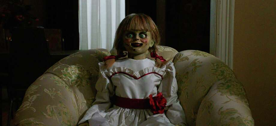 """This image released by Warner Bros. Pictures shows a scene from the horror film, """"Annabelle Comes Home."""" (Warner Bros. Pictures via AP) / © 2019 Warner Bros. Entertainment Inc. All Rights Reserved."""