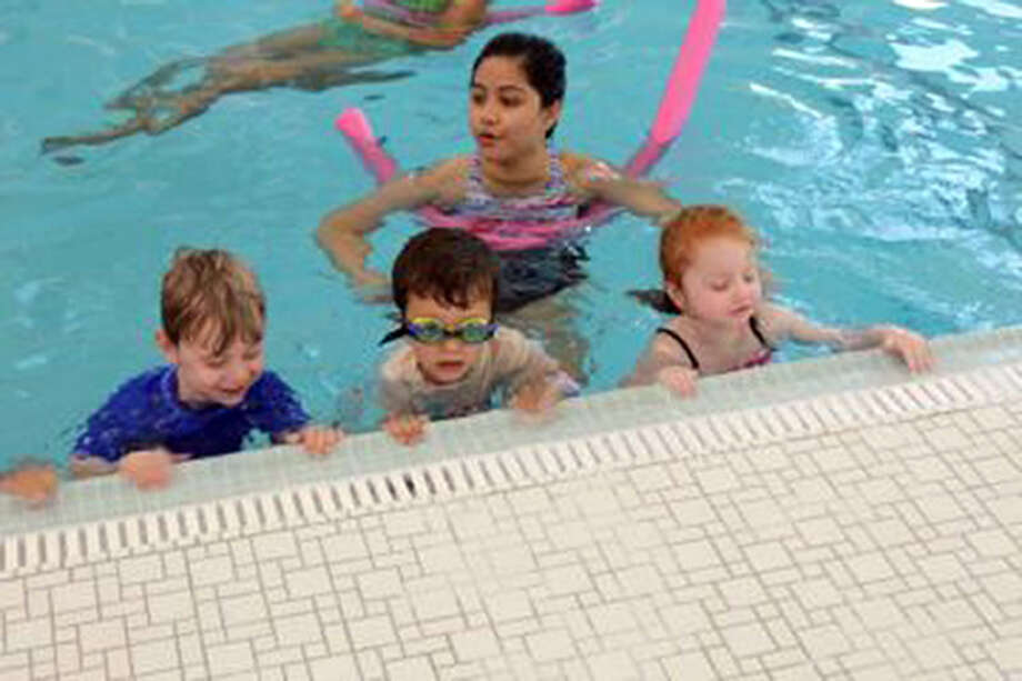 The New Canaan Forese Family Pool at the New Canaan YMCA that includes a warm, and lap pool for use all year. From left, James Cardon, Kevin Fleming and Ava Spergel take a preschool swim lesson in the pool when it opened in 2017. Contributed photo