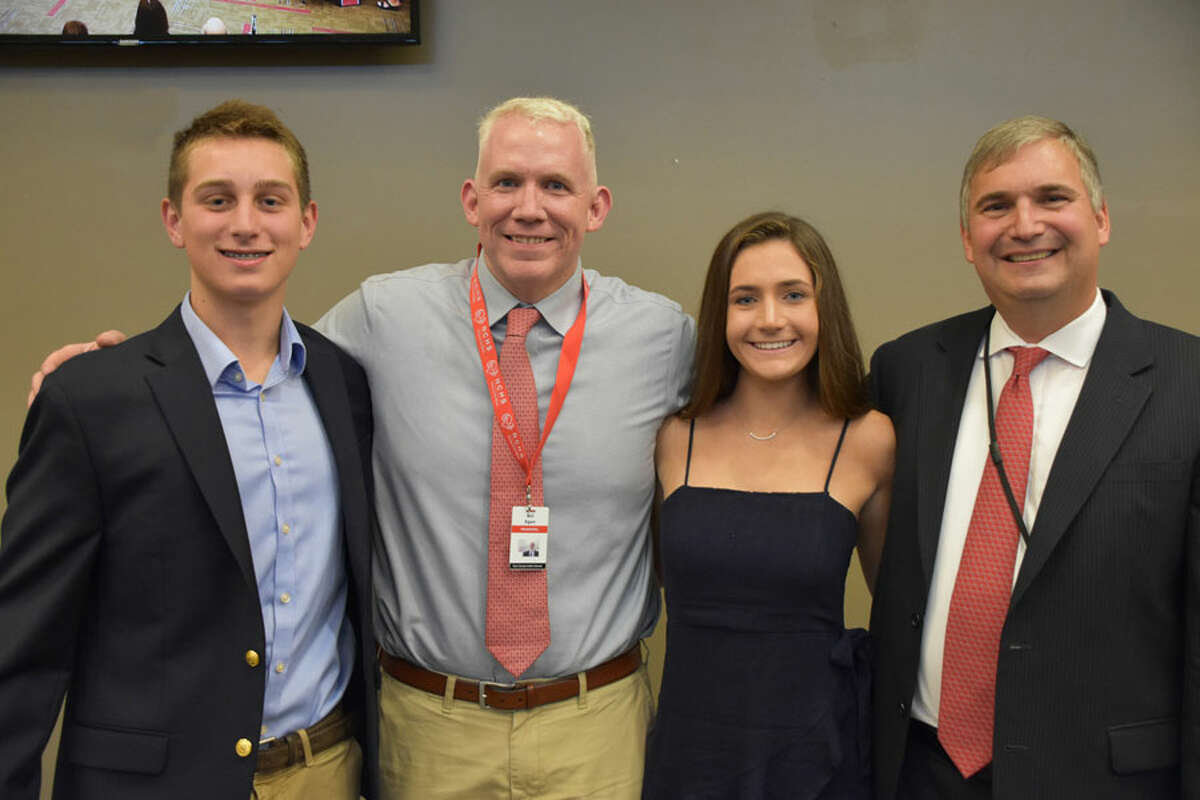 The 2019 New Canaan High School winners of the CABE Student Leadership Awards were introduced to the Board of Education Monday night, June 10. From left are winner winner Gray Farley, New Canaan High School Principal Bill Egan, winner Caroline Ciofi and Superintendent of Schools Dr. Bryan Luizzi. New Canaan High School / Contributed photo