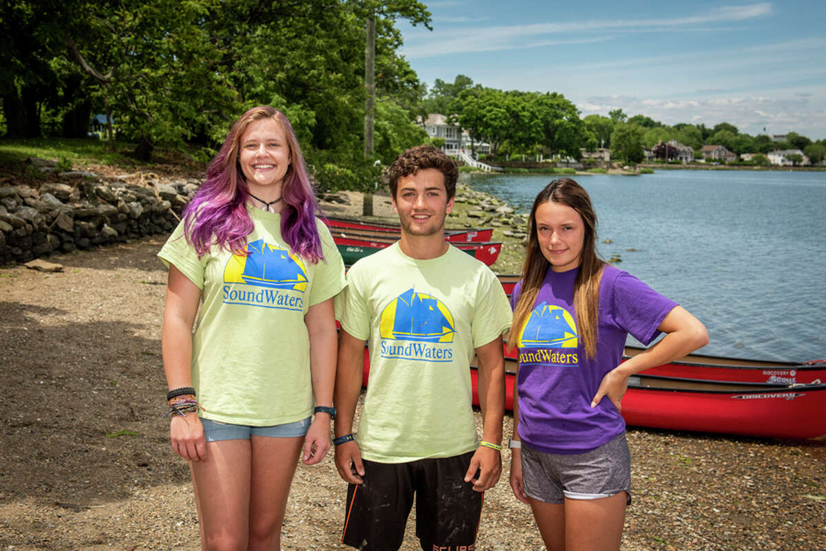 New Canaan High School senior interns Virginia Smith, Max Findlay and Evelyn Pickering take a break between teaching classes at SoundWaters at Cove Island Park in Stamford, where they interned this spring. Michael Bagley / Soundwaters / Contributed photo