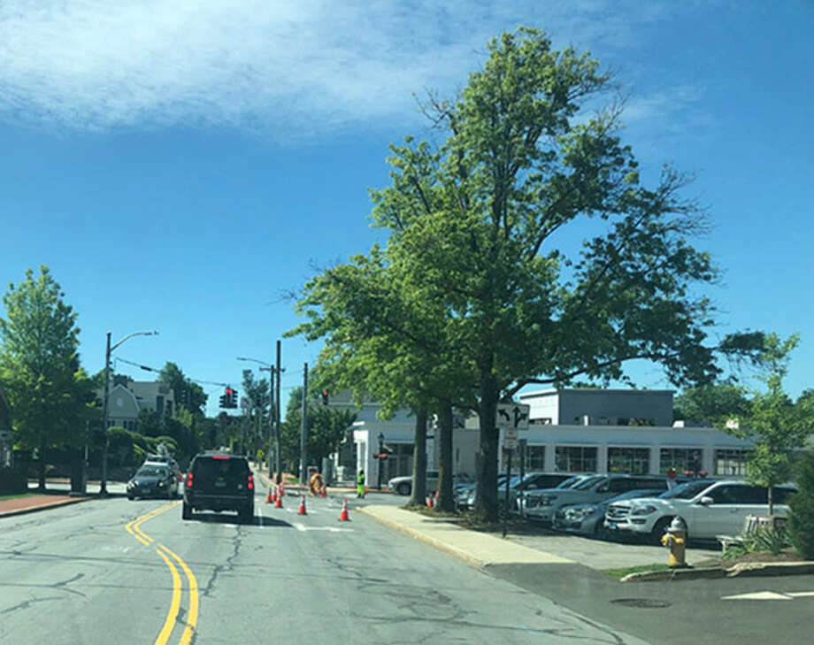 A crew from Burns Construction works on the gas expansion project for the Town of New Canaan, Conn., at the intersection of Park Street, Pine Street and Cherry Street, in the town's downtown district, on Tuesday, June 4, 2019. Contributed photo