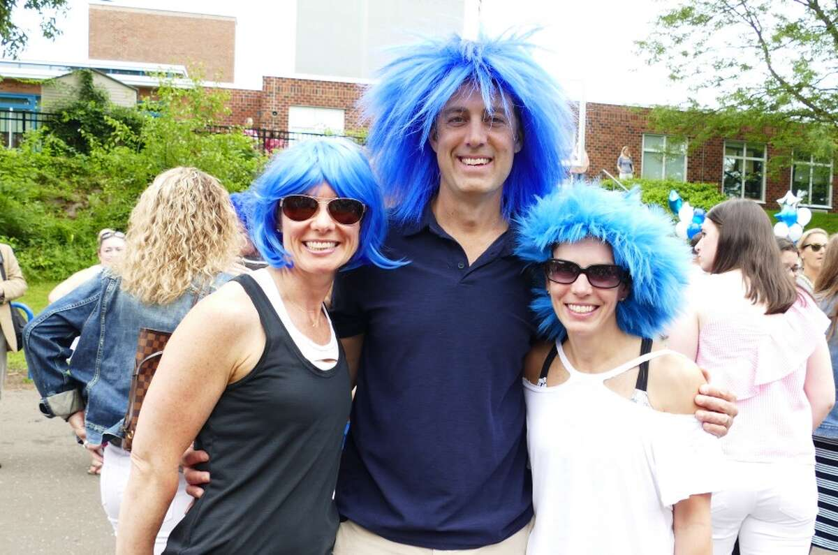 Parents Kelly and Lee Ratner and Christina Smith wore blue wigs in honor of Principal Joanne Rocco who is retiring. - Grace Duffield photos
