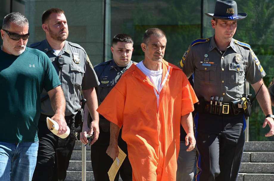 Fotis Dulos exits Stamford Superior Court with bondsman, state police and judicial marshals after posting $500,000 bond. Photo: Erik Trautmann / Hearst Connecticut Media