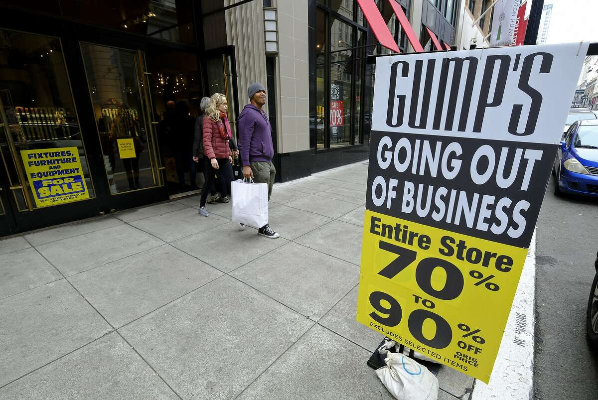 People exit the Gump's store during its liquidation sale Thursday, Dec. 20, 2018, in San Francisco. San Francisco's oldest department store, Gump's, is closing its doors after 157 years in business. Gump's was founded in 1861 as a frame and mirror shop. Its final day of business is Sunday. (AP Photo/Eric Risberg)