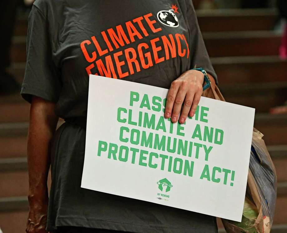 People rally in support for the climate and community protection act at the New York State Capitol on Monday, June 17, 2019 in Albany, N.Y. (Lori Van Buren/Times Union) Photo: Lori Van Buren