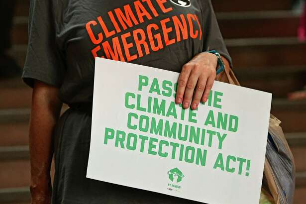 People rally in support for the climate and community protection act at the New York State Capitol on Monday, June 17, 2019 in Albany, N.Y. (Lori Van Buren/Times Union)