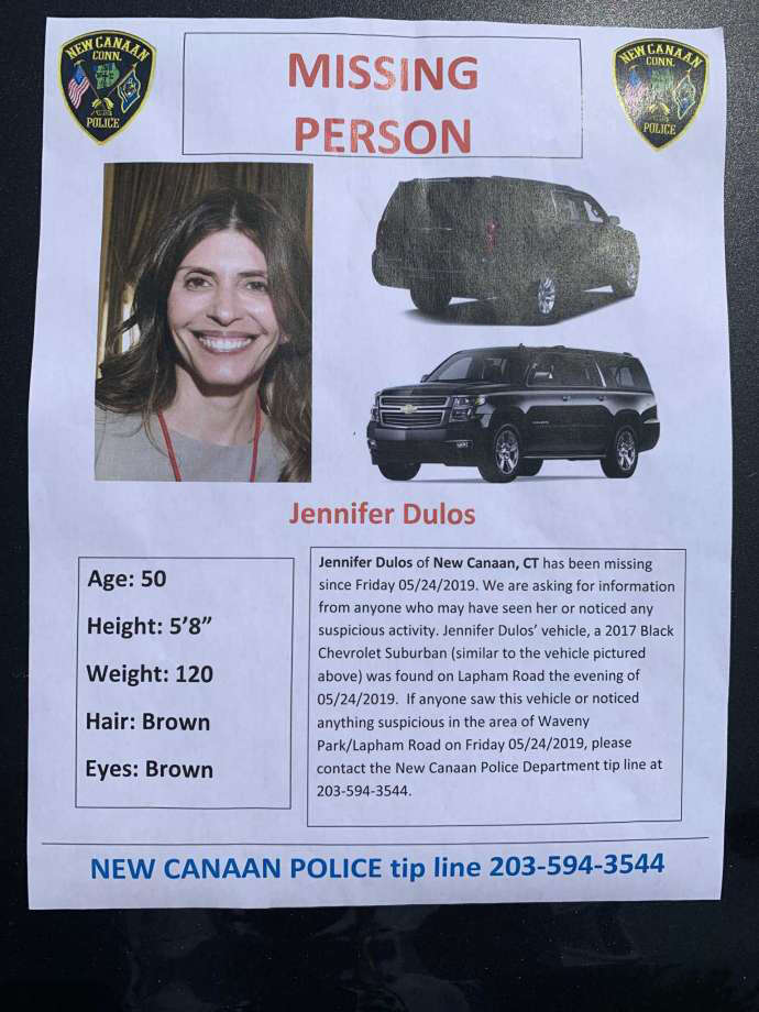Police handed out missing persons flyers on Friday near where Jennifer Dulos' SUV was found on Lapham Road last week. Photo: John Kovach / Hearst Connecticut Media