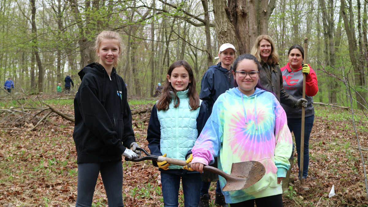 Volunteers from National Charity League help the New Canaan Land Trust plant native trees at the Silvermine-Fowler Preserve on Arbor Day. New Canaan Land Trust / Contributed photo