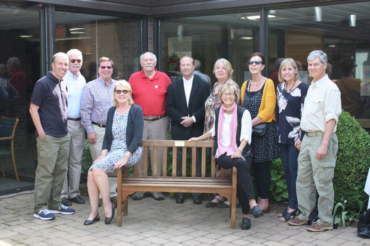 Classmates, friends and family of Peter Lewis celebrate the dedication of a bench at Waveny Care Center in his honor. Contributed photo