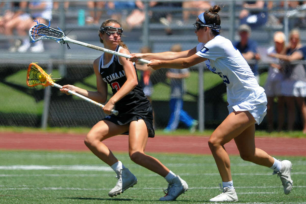 New Canaan's Dillyn Patten looks for room to operate while Darien's Maddie Joyce defends during the CIAC Class L girls lacrosse final Saturday at Jonathan Law High School in Milford. - Christian Abraham/Hearst Connecticut Media