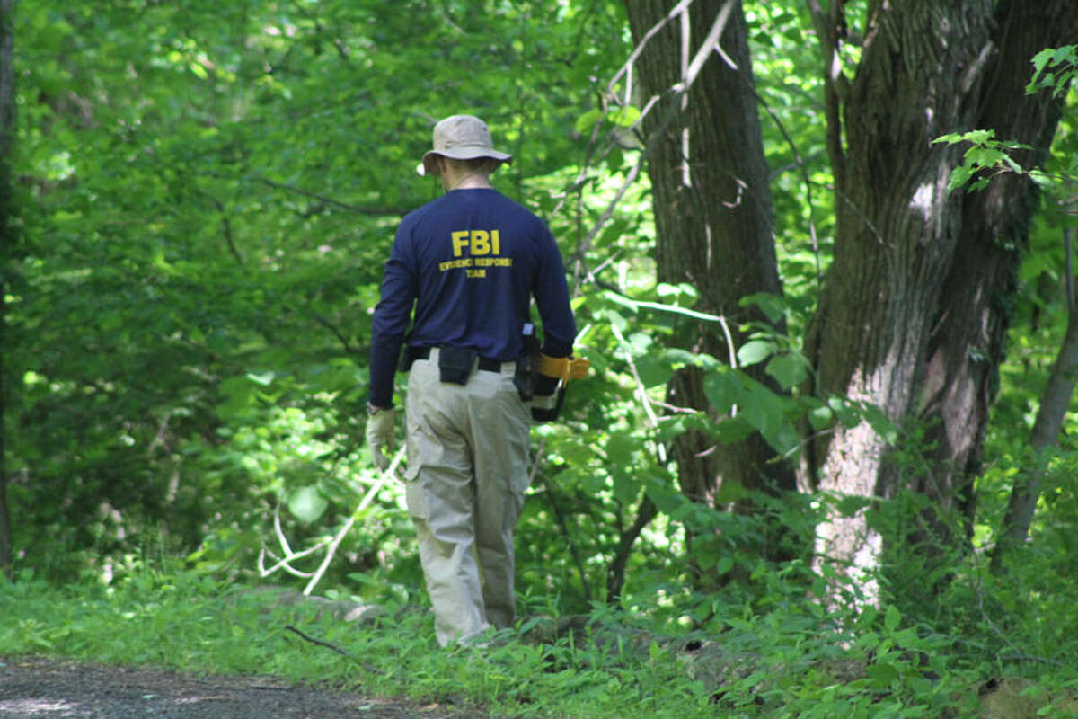The FBI scoured a secluded area of Waveny Park near Lapham Road for clues in the case of Jennifer Dulos, the mother of five not seen since May 24. A petition on change.org is now calling for cameras throughout the park.