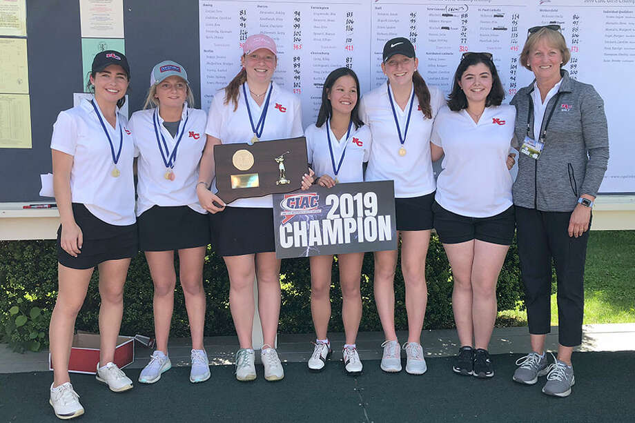 The New Canaan Rams shot a 320 and won their third consecutive CIAC state girls golf championship at Tashua Knolls Golf Course in Trumbull on Tuesday, June 4, 2019. From left are Morgan Hibbert, Stirling Legge, Meghan Mitchell, Julia Bazata, Molly Mitchell, Michelle Siegel and head coach Priscilla Schulz. — Dave Stewart/Hearst Connecticut Media / Hearst Connecticut Media