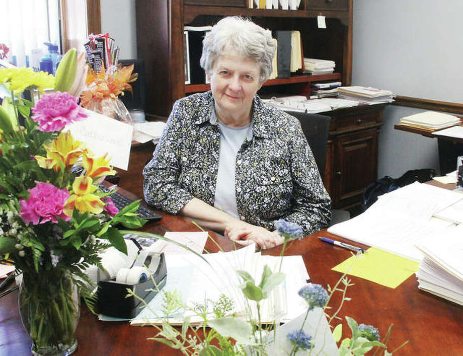 Retiring Jerseyville City Clerk Catherine Ward is surrounded by flowers from well-wishers Tuesday morning. Ward, who has worked for the city for 45 years, announced her retriremewnt on June 20.