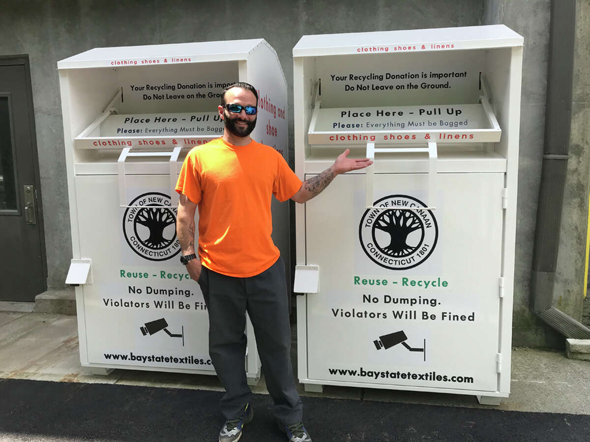 Bins where textiles can be recycled have been set up at the New Canaan Transfer Station. Eric Pot stands next to the one of the new textile bins. Contributed photo