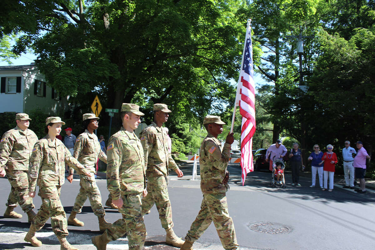 The American flag is carried toward the front of New Canaan's Memorial Day Parade Monday, May 27, 2019. John Kovach photo