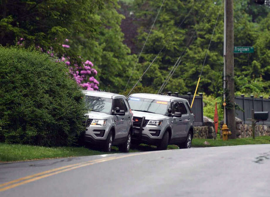 Connecticut State Police park their vehicles near the neighborhood of missing person Jennifer Dulos in New Canaan, Conn. Tuesday, May 28, 2019. Dulos was reported missing Friday evening and police searched the area surrounding her neighborhood with K-9 units on Tuesday. The search shifted back to her neighborhood, and Irwin Park Thursday afternoon, May 30, 2019. — Tyler Sizemore photo