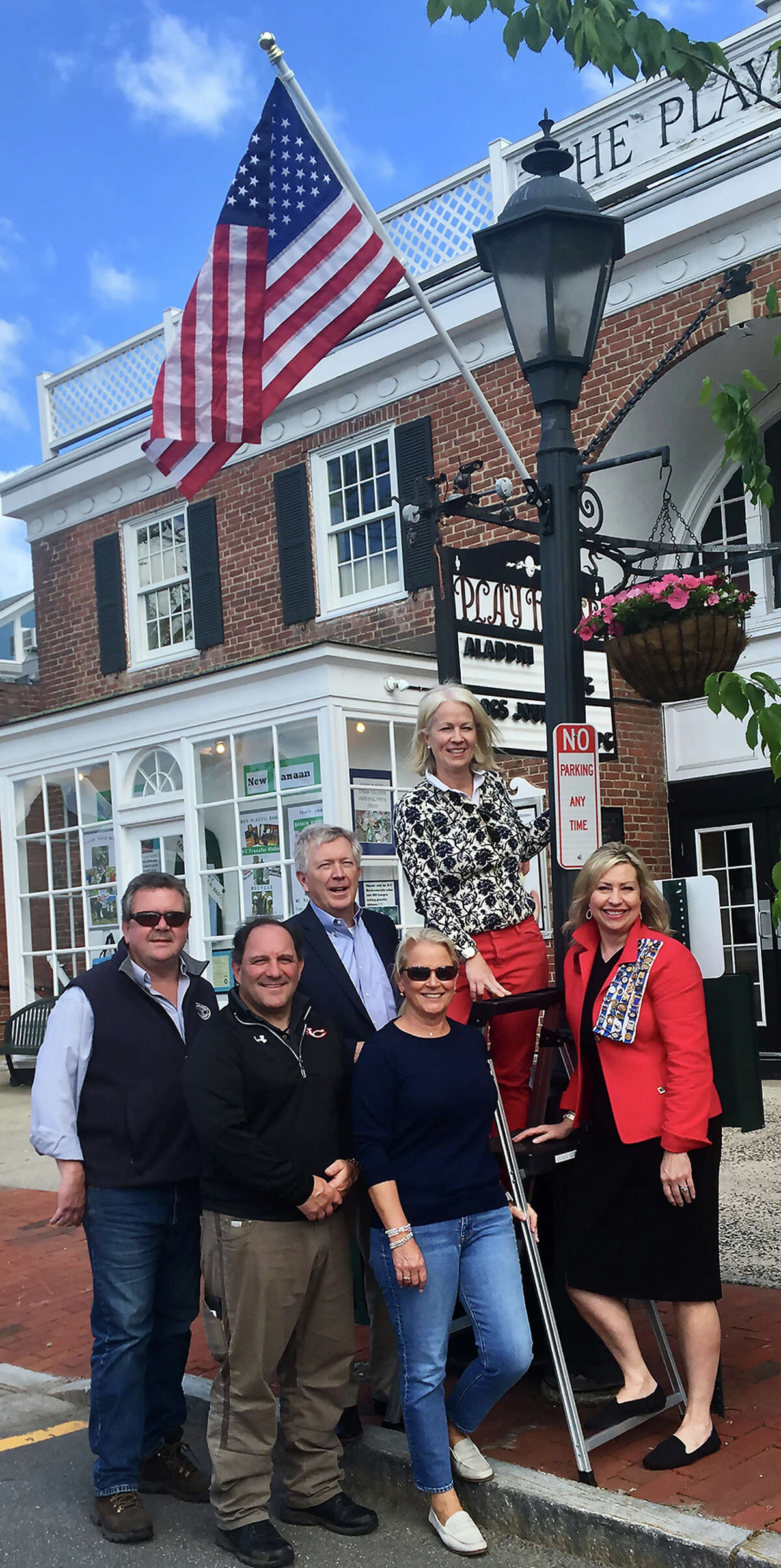 Unveiling the new flags in downtown New Canaan are Highway Superintendent Mose Saccary, Director of Public Works Tiger Mann, First Selectman Kevin Moynihan, Chamber of Commerce Executive Director Tucker Murphy, Meredith Bach and Immediate Past DAR Chapter Regent Lisa Melland. Contributed photo