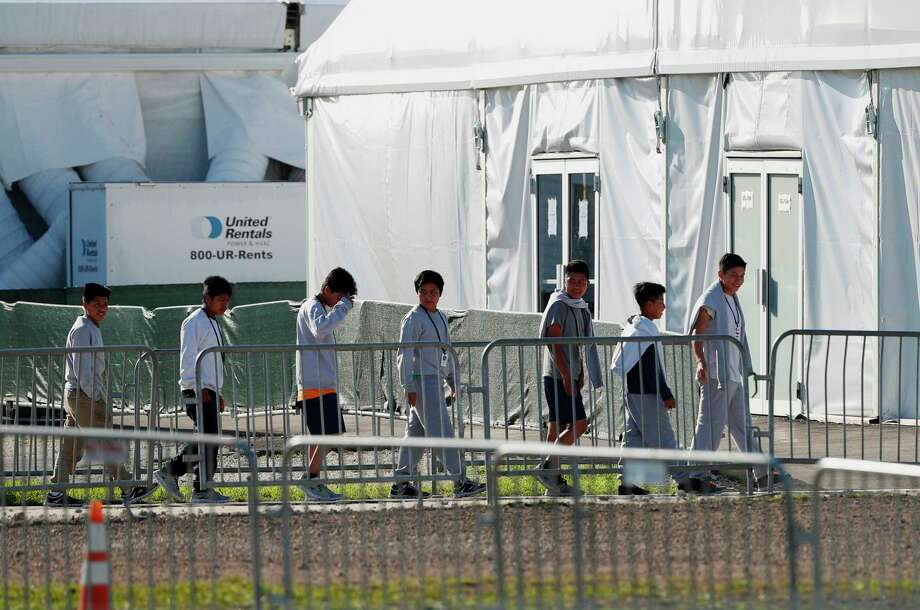 FILE - In this Feb. 19, 2019 file photo, youngsters line up to enter a tent at the Homestead Temporary Shelter for Unaccompanied Children in Homestead, Fla.  (AP Photo/Wilfredo Lee, File) Photo: Wilfredo Lee / Copyright 2019 The Associated Press. All rights reserved