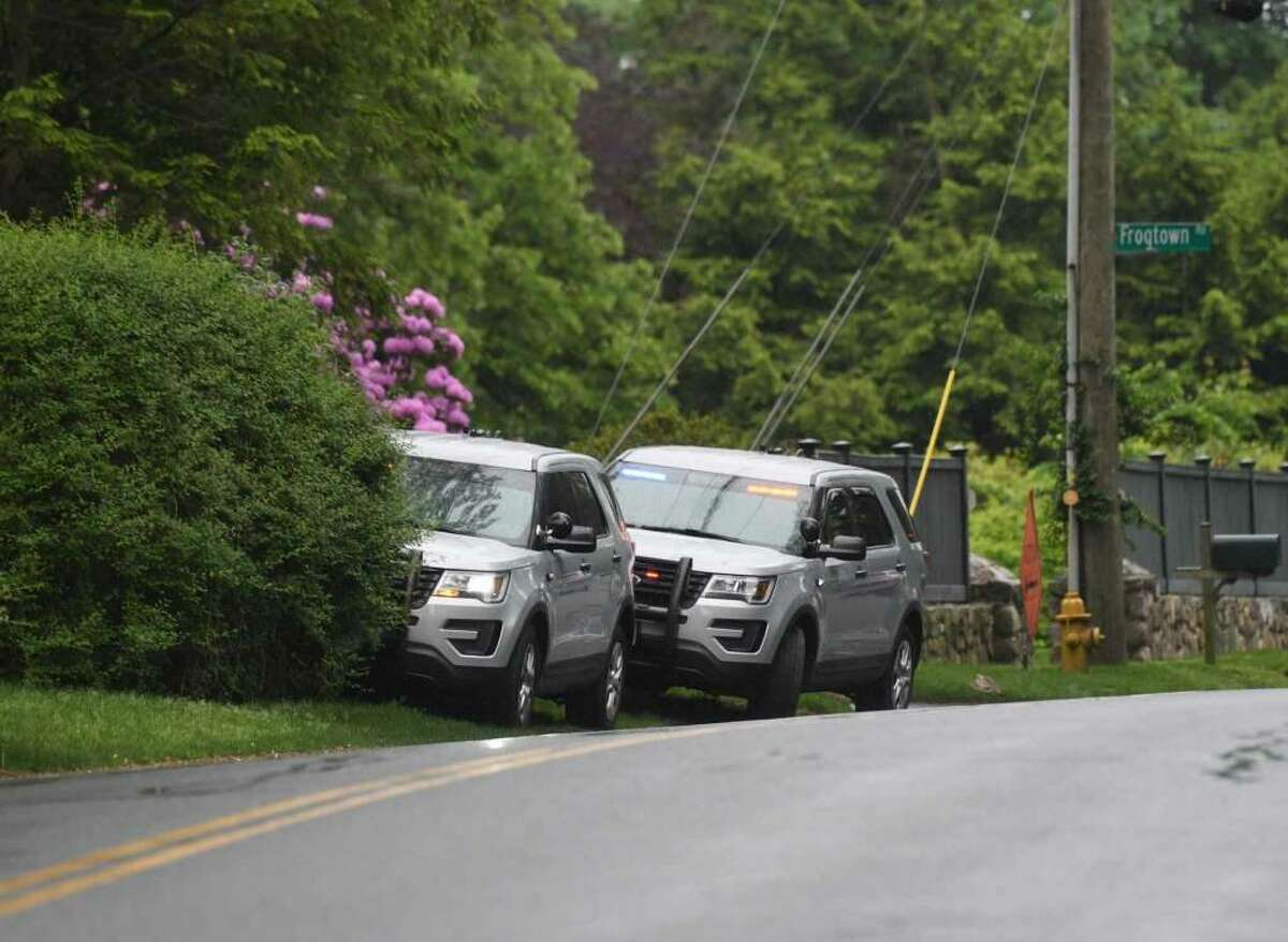 Connecticut State Police park their vehicles near the neighborhood of missing person Jennifer Dulos in New Canaan, Conn. Tuesday, May 28, 2019. Dulos was reported missing Friday evening and police searched the area surrounding her neighborhood with K-9 units on Tuesday. -Tyler Sizemore photo