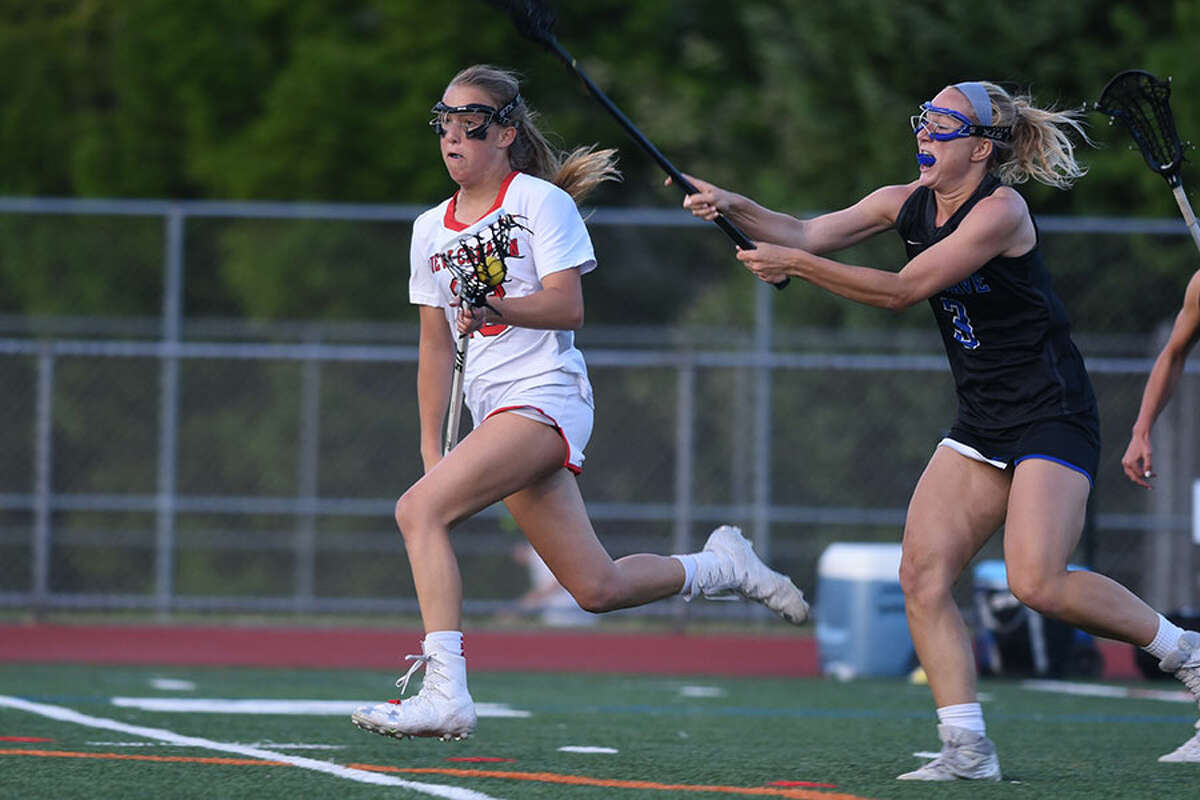 New Canaan's Hollis Mulry gets out in front through the midfield during the FCIAC girls lacrosse final at Norwalk High School on May 22. - Dave Stewart/Hearst Connecticut Media