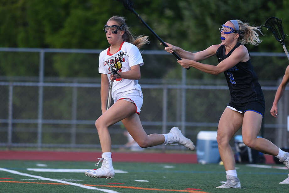 New Canaan's Hollis Mulry gets out in front through the midfield during the FCIAC girls lacrosse final at Norwalk High School on May 22. — Dave Stewart/Hearst Connecticut Media