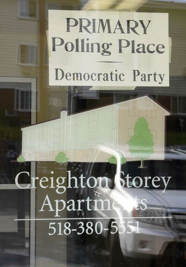 A sign for the primary polling place Democratic Party is seen in a window at the Creighton Storey Homes on Tuesday June 25, 2019 in Albany, N.Y. (Lori Van Buren/Times Union) Photo: Lori Van Buren, Albany Times Union / 20047326A