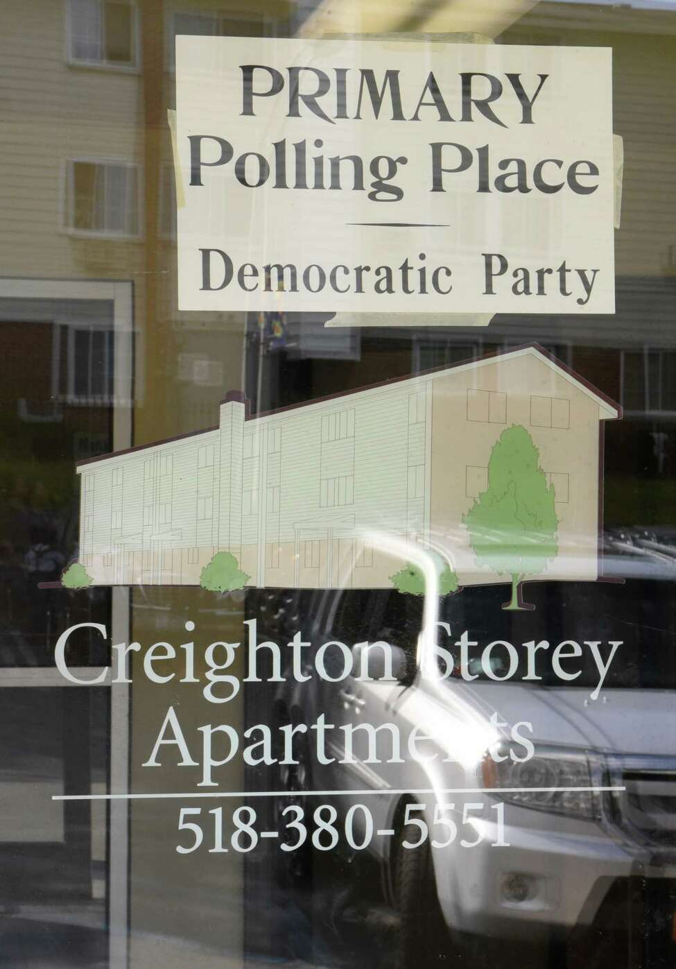 A sign for the primary polling place Democratic Party is seen in a window at the Creighton Storey Homes on Tuesday June 25, 2019 in Albany, N.Y. (Lori Van Buren/Times Union)