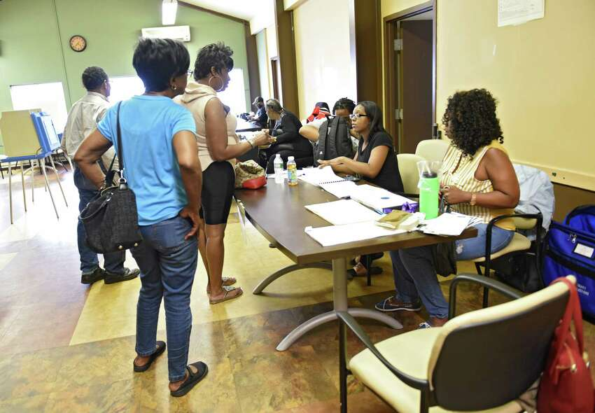People sign in to vote on primary day at the Creighton Storey Homes on Tuesday June 25, 2019 in Albany, N.Y. (Lori Van Buren/Times Union)