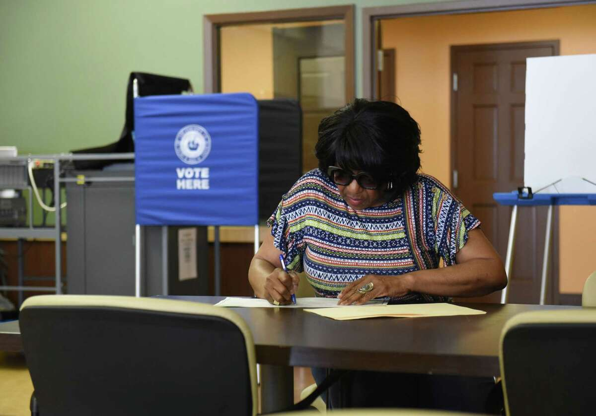 Mary Ann Himes goes over her ballot before voting on primary day at the Creighton Storey Homes on Tuesday June 25, 2019 in Albany, N.Y. (Lori Van Buren/Times Union)